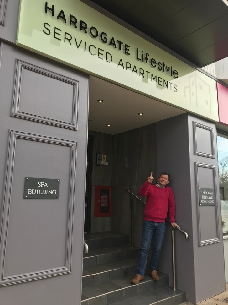 Owner stood outside Harrogate Lifestyle Apartments